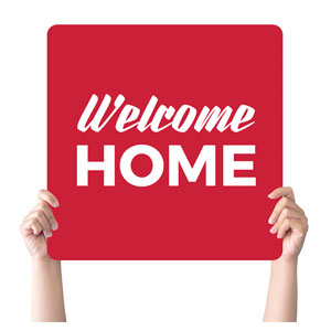 Red Welcome Home Handheld sign